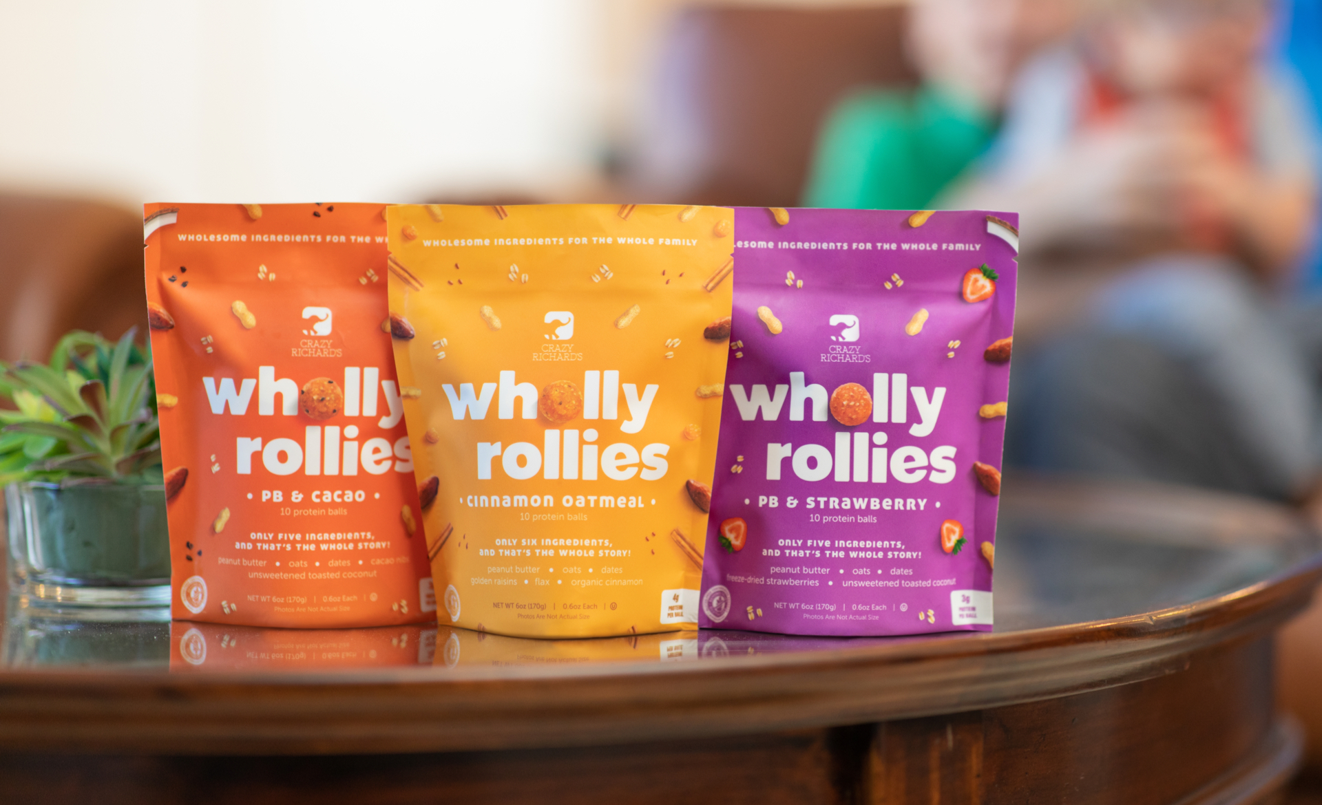Wholly Rollies packaging on a glass coffee table