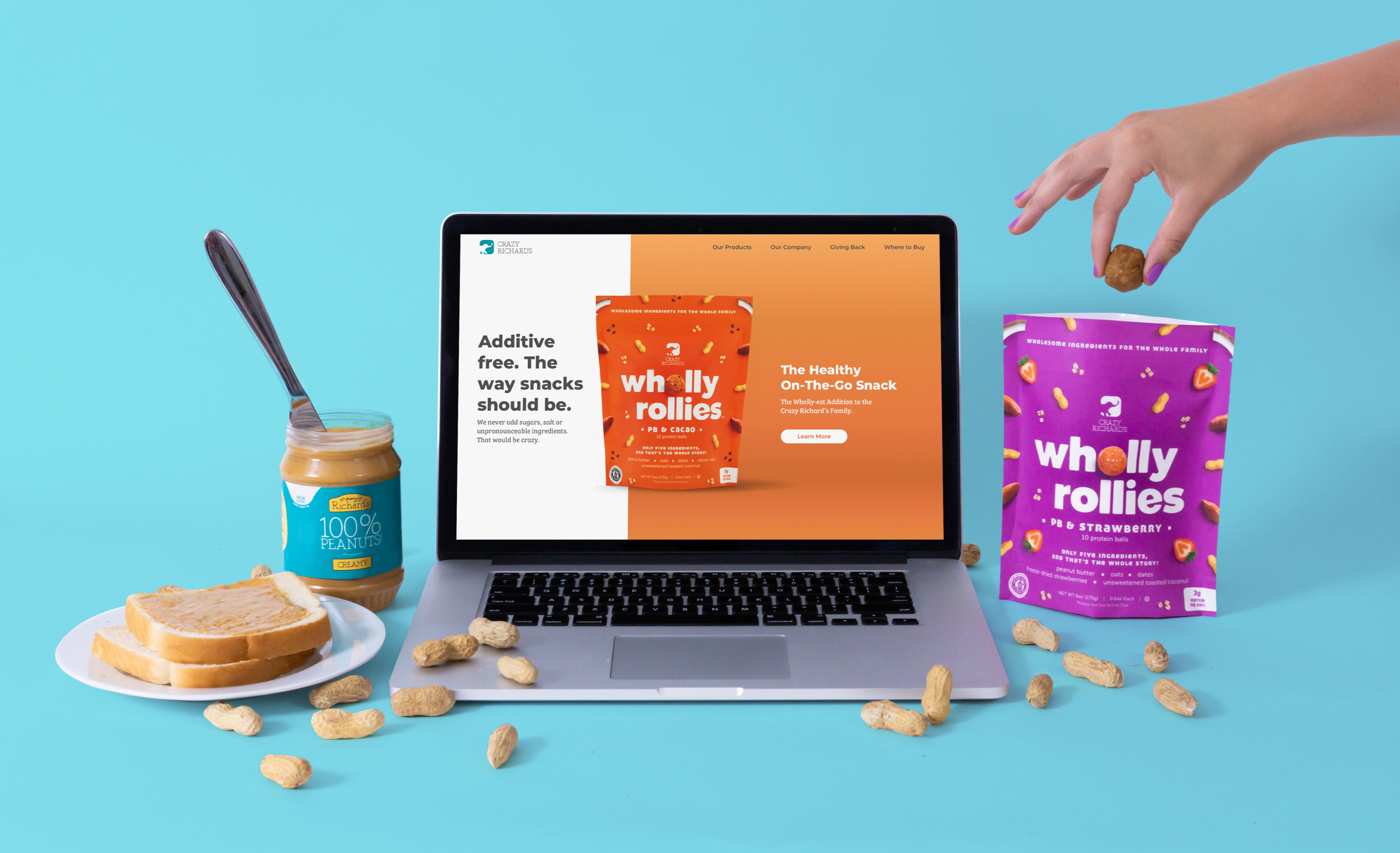 Crazy Richard's website on a laptop next to a peanut butter sandwich and Wholly Rollies