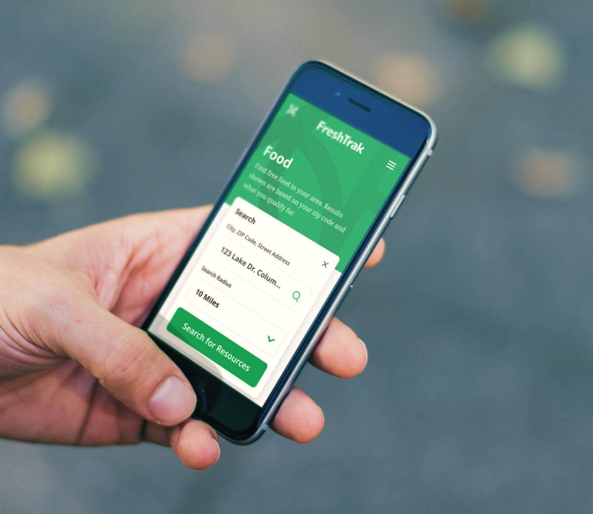 Customer using FreshTrak on their mobile phone to search for food events nearby